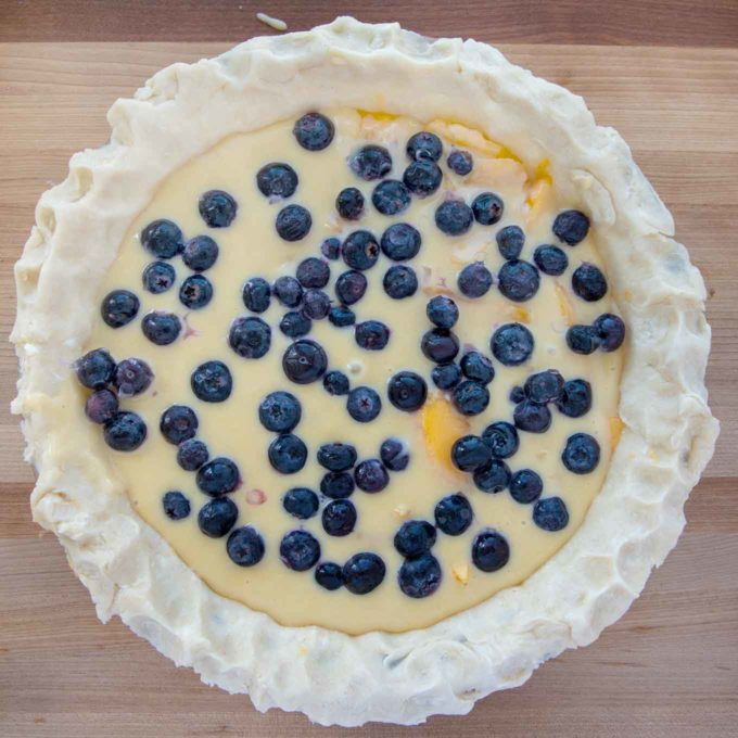 blueberries added to custard filling in the pie crust