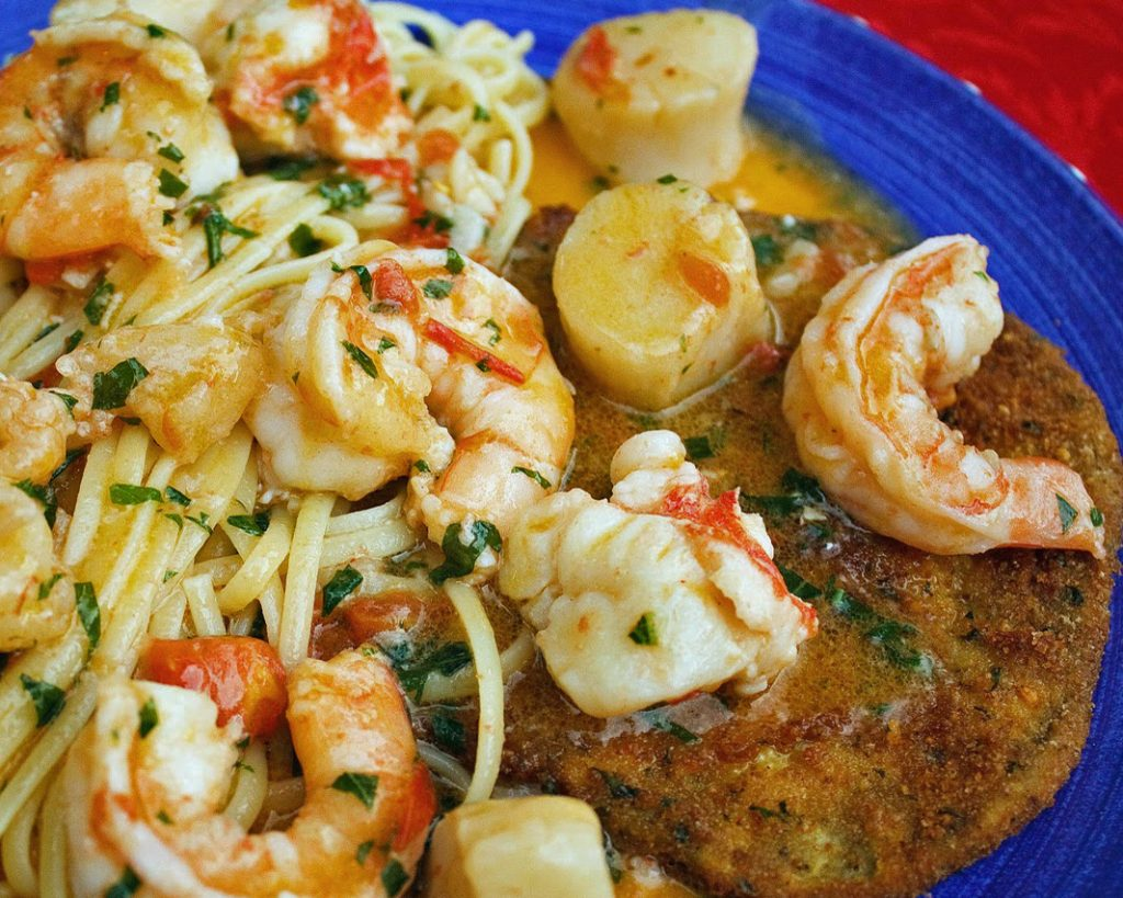 lobster, shrimp and scallops in a scampi sauce served over linguine and eggplant