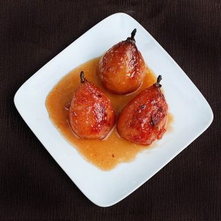 3 honey glazed roasted pears on a white plate