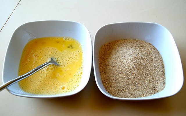 bowls of beaten eggs and bread crumbs