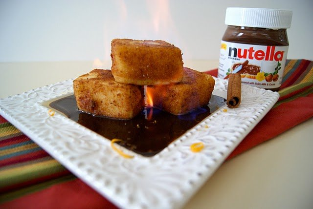 Orange Creams with a Nutella Ganache flambeed sitting on a square white plate
