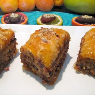 pieces of apricot mango baklava on a white platter