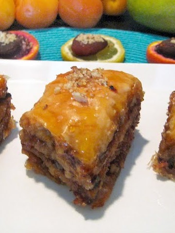 pieces of apricot mango baklava on a white platter