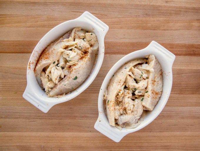 flounder fillets stuffed with crabmeat in baking dishes