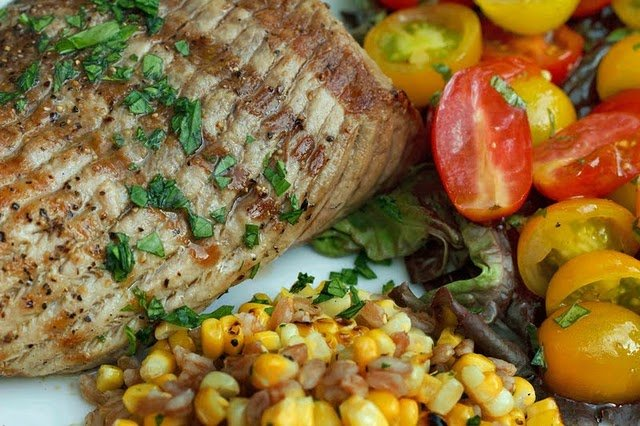 close up of grilled Chesapeake bay ray next to vegetables