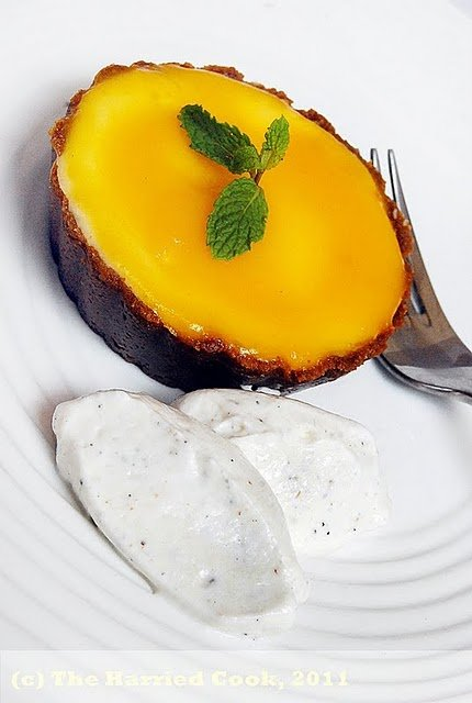 mango mascarpone cheesecake on a white plate