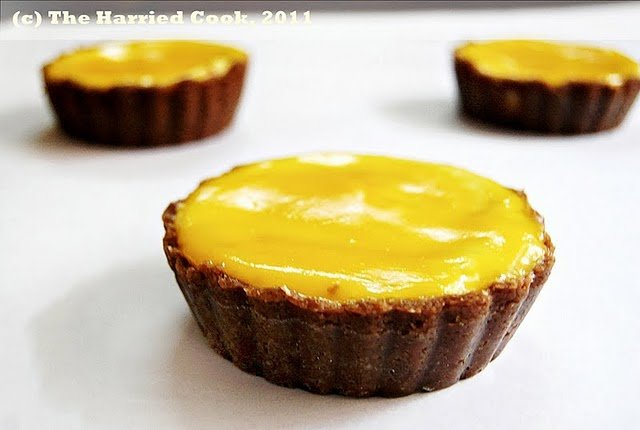 3 mango mascarpone cheesecake on a white counter