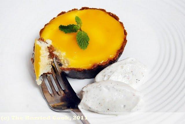 mango mascarpone cheesecake with a fork on a white plate