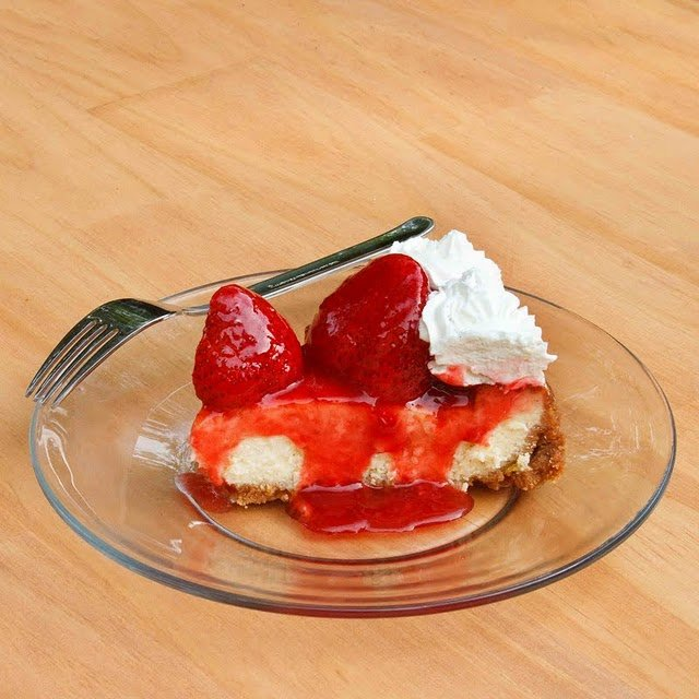 slice of Mascarpone Strawberry Cheesecake on a glass plate