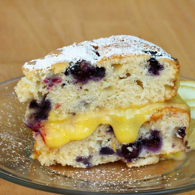 slice of blueberry lemon cake on clear glass plate