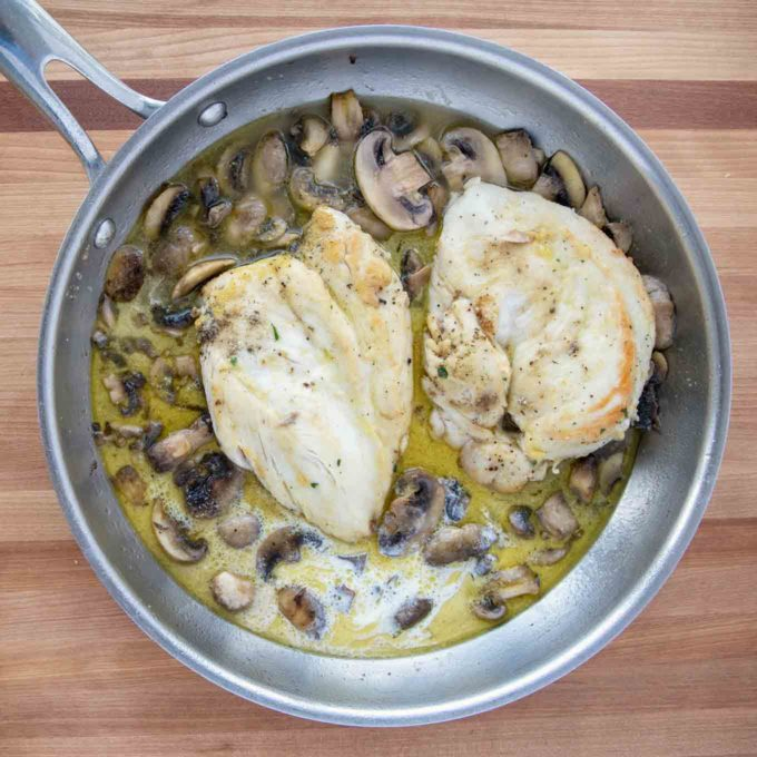 2 sauteed chicken breasts in sauce for chicken saltimbocca