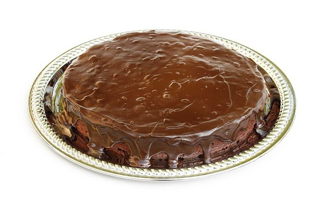whole chocolate torte on a silver platter