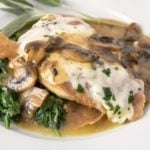 close up chicken saltimbocca on a white plate