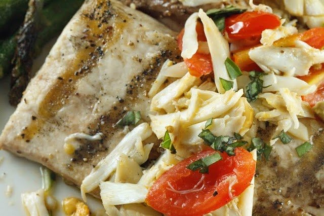 close up of grilled mahi-mahi topped with crabmeat and grape tomatoes