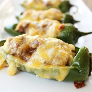 cheesy stuffed jalapeno peppers on a white tray