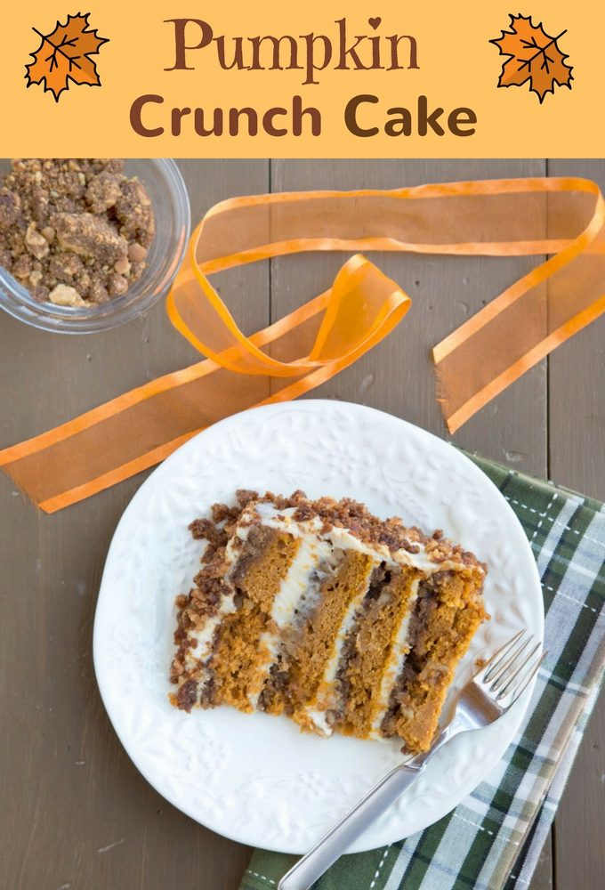 slice of pumpkin crunch cake on a white with a fork and a green plaid napkin
