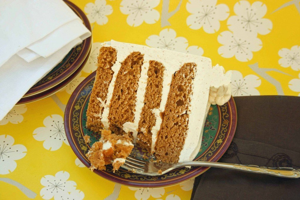 slice of pumpkin marshmallow brown butter cake on a plate with a fork in the cake