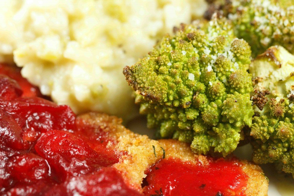 cooked romanesco and partial view of turkey Milanese