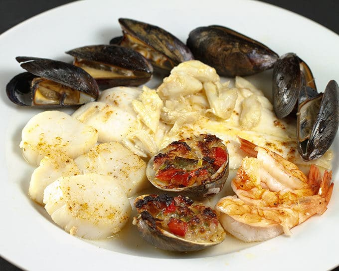 broiled seafood combination on a white plate