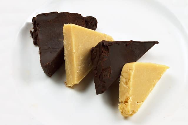 slices of dark chocolate and white chocolate pate on a white plate