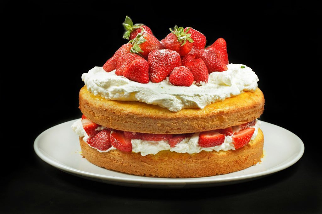 2 layer Strawberry Cake with whipped cream and strawberries between the layers and on top
