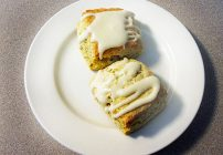 2 orange cardamom scones on a white plate