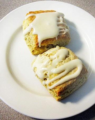2 orange cardamom scones on a white plate