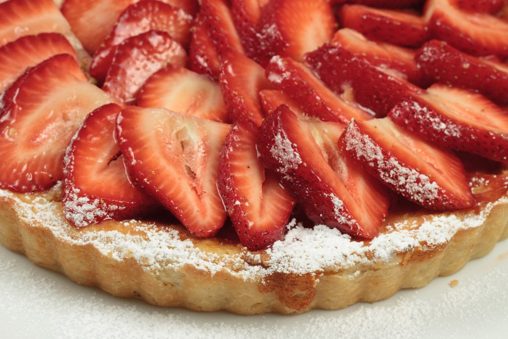 partial view of an Italian strawberry ricotta crostata