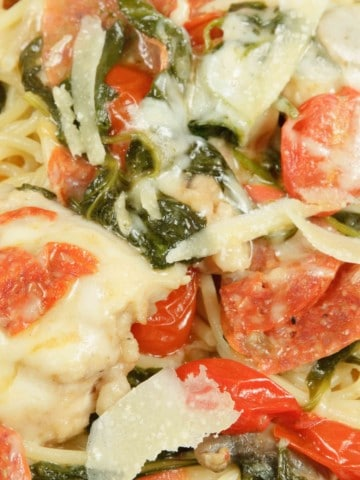 A close up of chicken marselena over pasta