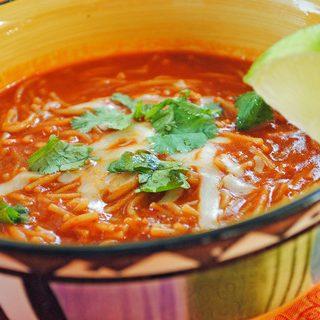 bowl of sopa fideos with cilantro garnish on top