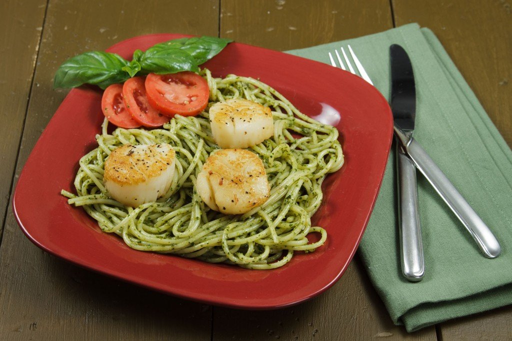 sea scallops pan seared served with linguine tossed with freshly made pesto