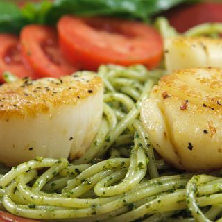 pan seared scallops served with linguine alla pesto
