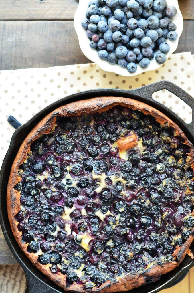 blueberry lemon Dutch baby in a cast iron pan