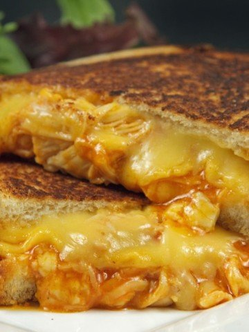 buffalo grilled cheese sandwich cut in half and stacked