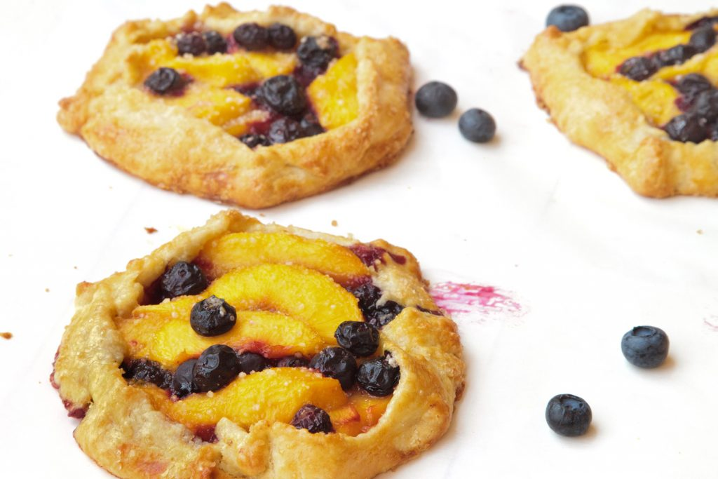 blueberry peach crostata on a white tray