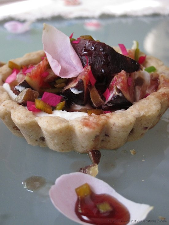 Fig Tart with goat cheese on a white plate