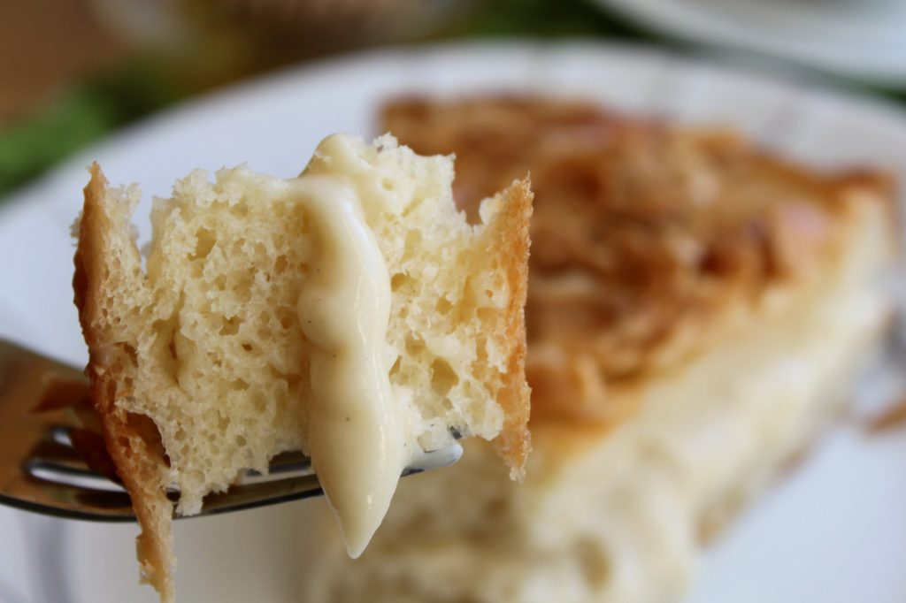 A close up of a forkful of bee sting cake