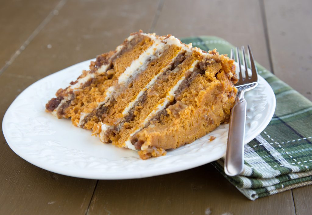 slice of pumpkin crunch cake on a white plate with a fork