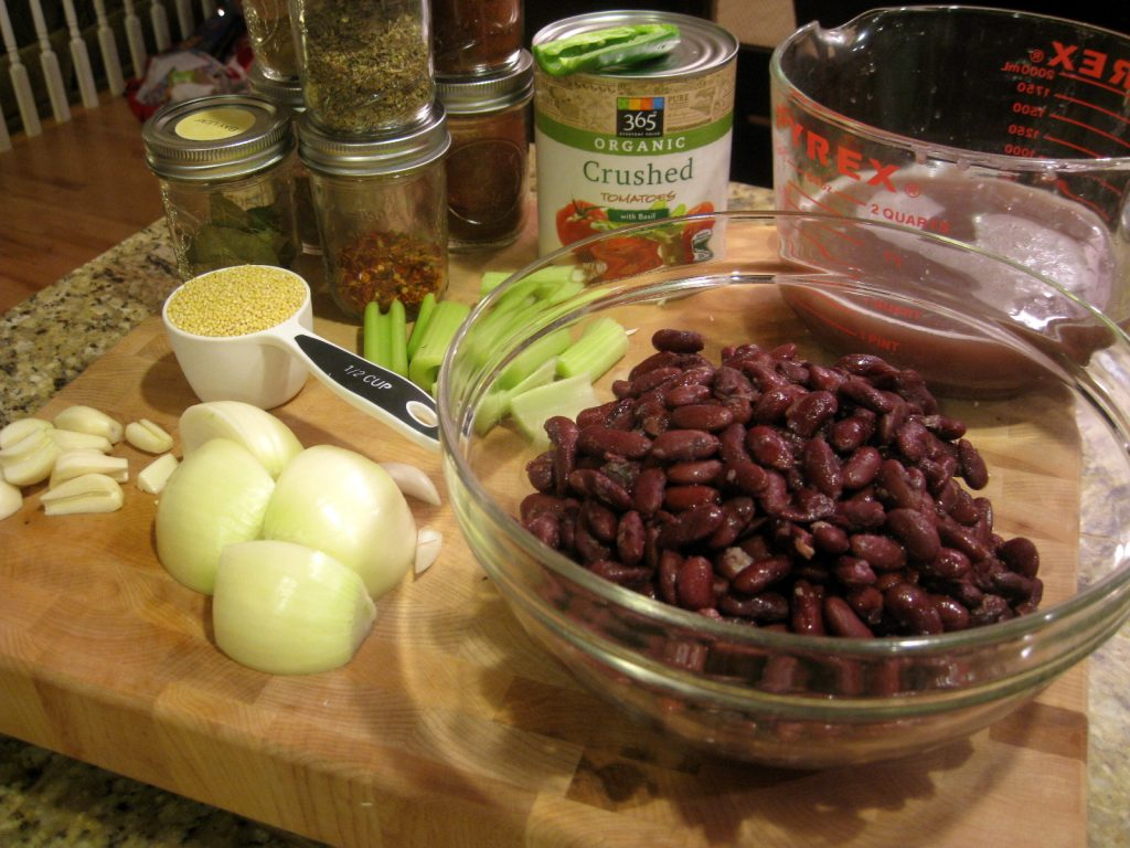 ingredients to make vegan Red Bean Chili on a cutting board