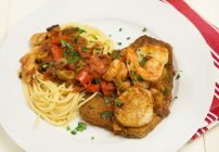 Sicilian style seafood, shirmp and scallops with quick fried eggplant in a sicilian style sauce