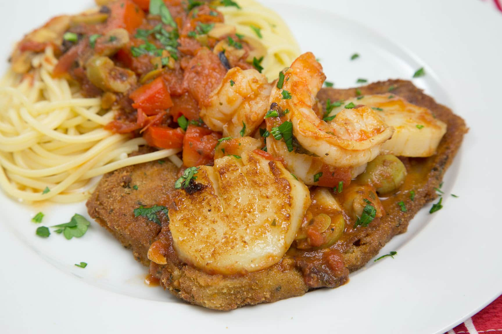 Scallops And Shrimp Over Pasta And Fried Eggplant