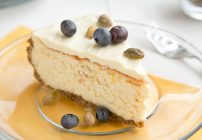 Meyer Lemon Mascarpone Cheesecake with a pistachio crust and white chocolate topping