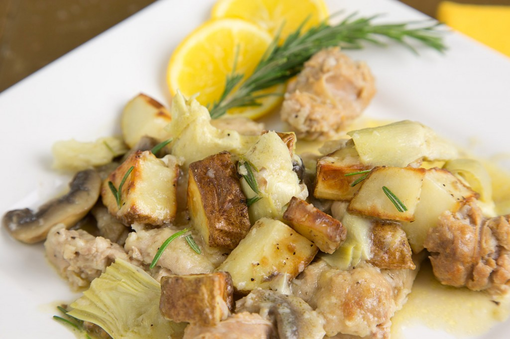 chicken with sweet sausage and roasted potatoes in a lemon rosemary sauce