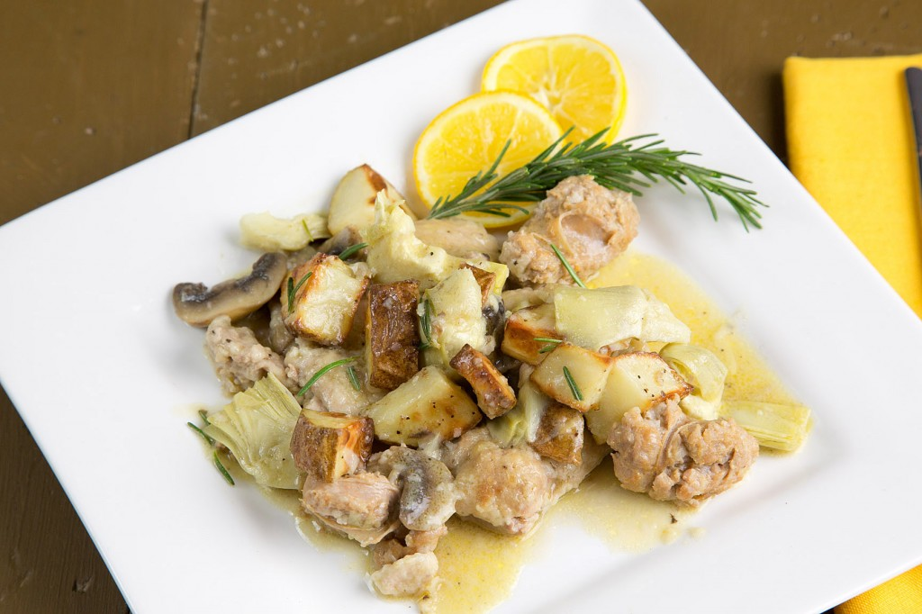 chicken with sweet sausage, roasted potatoes, mushrooms and artichokes in a lemon rosemary sauce