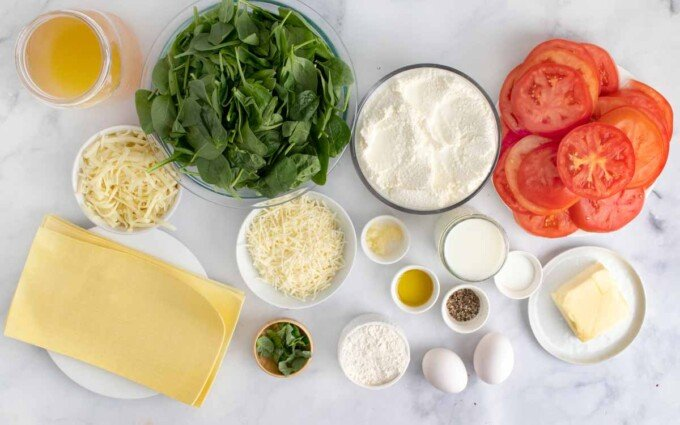 overhead view of ingredients to make Tomato and spinach lasagna