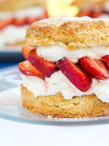 Individual Strawberry Shortcake with whipped cream, strawberries, scones, National dairy month