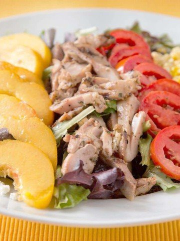 JSummer Salad with Chicken , feta, peaches, tomatoes and roasted corn