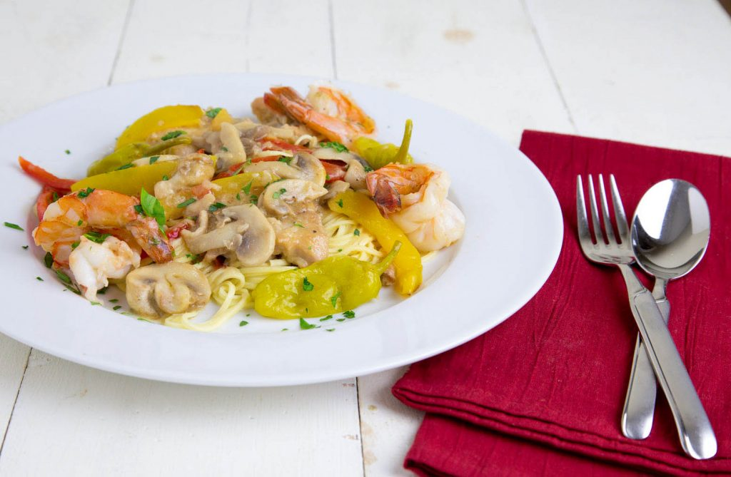 Gulf Shrimp, Chicken tenders , tuscan peppers and mushrooms served over pasta.  askchefdennis.com