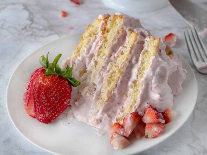 slice of strawberry cream plate on a white plate