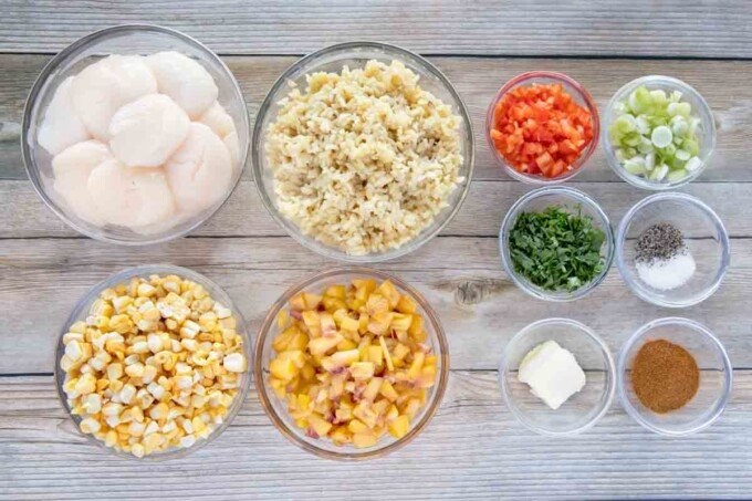 overhead view of ingredients to make pan seared scallops with rice, corn and peaches
